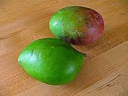 Two green mangos