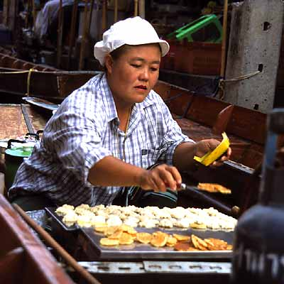 Woman making Grilled Coconut Cakse