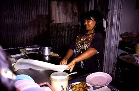 Woman making roti, in Songkla, Thailand