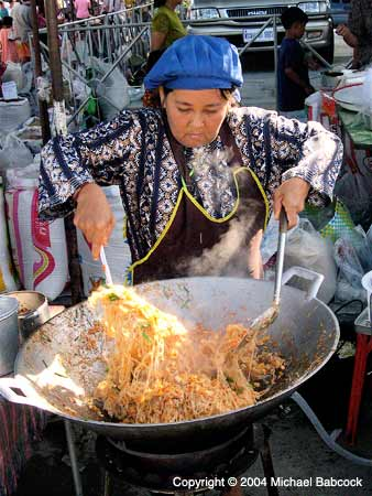 Woman Making Pad Thai