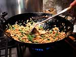 Stir-frying in a wok